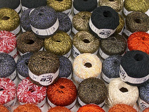 Fancy Yarns This mixed lot includes a total of 2000 gr (70.5 oz.) yarn. There is no standard for ball weight. Also disregard any information on the labels. You will get what you see in the photo. Brand ICE, fnt2-64082